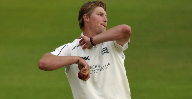 Ollie Rayner bowling for Middlesex in the County Championship.
