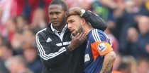 Ashkan Dejagah is consoled by Fulham team-mate Hugo Rodallega after the final whistle