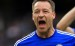 Chelsea's John Terry celebrates the draw after the game during the Barclays Premier League match at the Emirates Stadium, London.