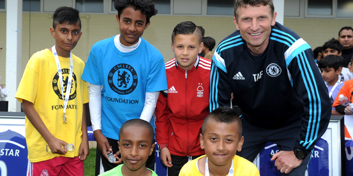 The winners along with Sam Khan (centre) and Tore Andre Flo after the Asian Stars event at Cobham Training Ground
