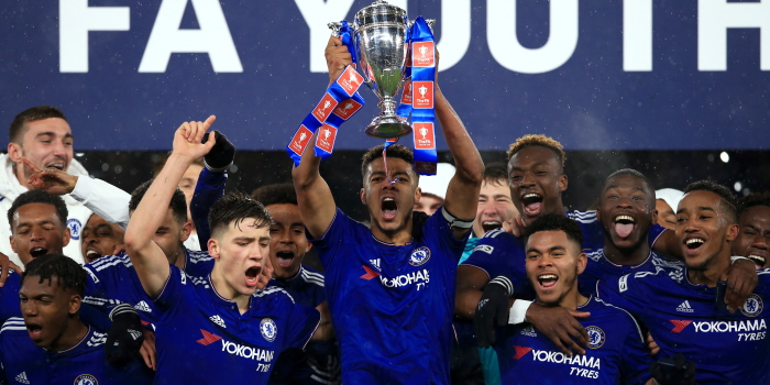 Chelseas Jake Clarke-Salter lifts the FA Youth Cup in celebration after the FA Youth Cup Final, Second Leg at Stamford Bridge, London.